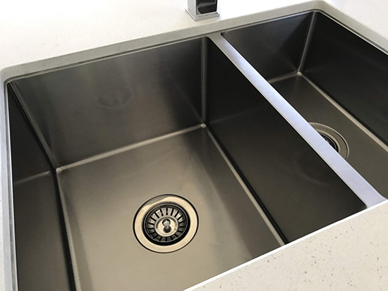 repaired stainless steel sink kitchen