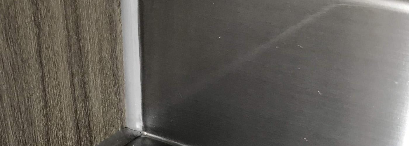 repaired stainless steel splashback